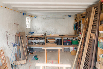 Various carpenter's tools and supplies in a garage.