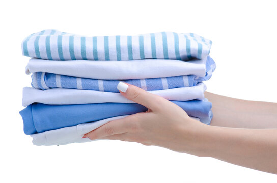 Stack folded cloth white blue in hand on white background isolation