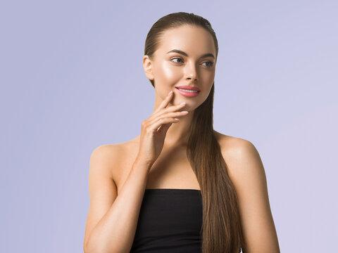 Woman portrait skin care long beauty brunette hair hand manicure touching face blue background