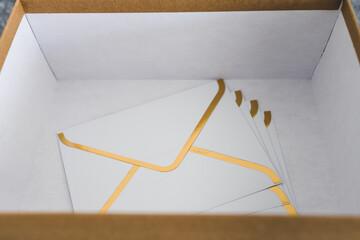 concept of inbox organisation, group of envelopes inside box metaphor of email inbox