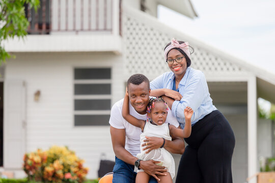 Cheerful african american family with luggage into new home, Happiness family concepts