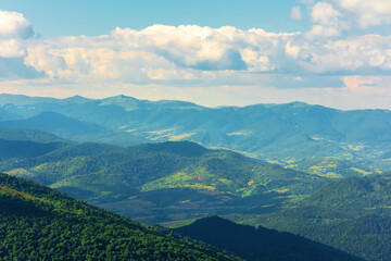 mountain landscape on a summer day. hills rolling from the valley up in to the distant ridge. view of the wonderful outdoor scenery beneath a sky with clouds