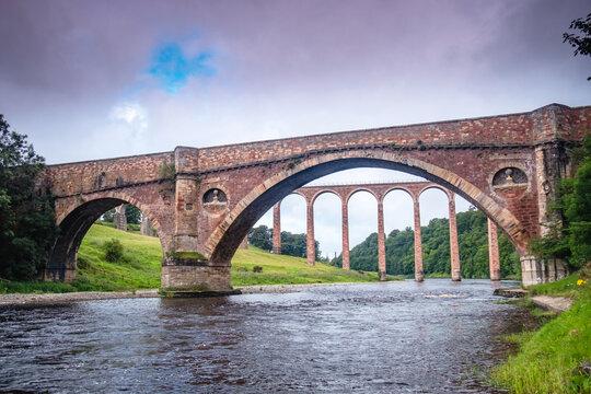 Leaderfoot Viaduct through the Old Drygrange Bridge, near Melrose, Tweed Vally, Scotland.