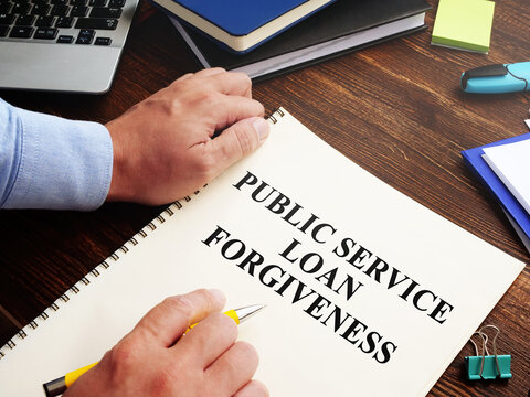 Public service loan forgiveness program PSLF on the desk.