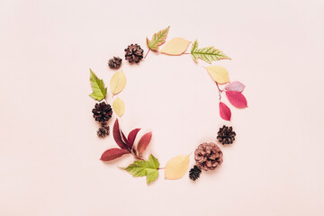 Autumn frame wreath of colorful leaves and cones. Autumn greeting background