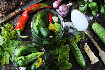 Jars of cucumbers, herbs and spices. Cucumber pickling concept. Cooking fermented cucumbers. Probiotics. Homemade pickles.