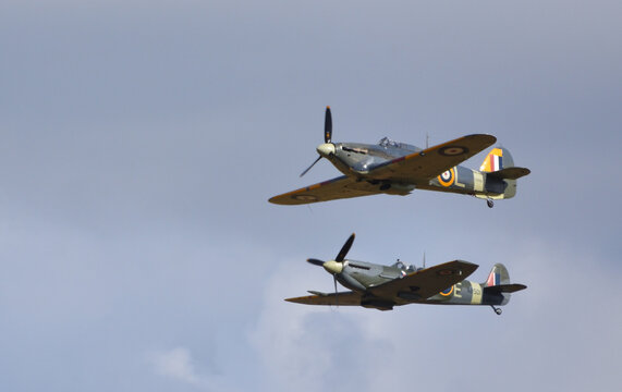 ICKWELL, BEDFORDSHIRE, ENGLAND - AUGUST 02, 2020:   Vintage Supermarine Spitfire MK Vc G-AW11 AR501 and Hawker Sea Hurricane 1B Z 7015  aircraft in flight