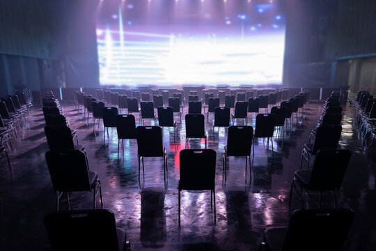selective focus seating arrangement for concerts.,Keep spaced between each  chairs make separate for social distancing concept to avoid Coronavirus (COVID-19) pandemic.