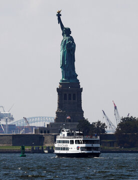 Nearly empty ferry boat runs to Statue of Liberty following outbreak of the coronavirus disease (COVID-19) in New York