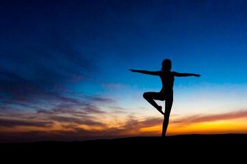 Silhouette of woman dancing at sunset, Gran Canaria, Spain