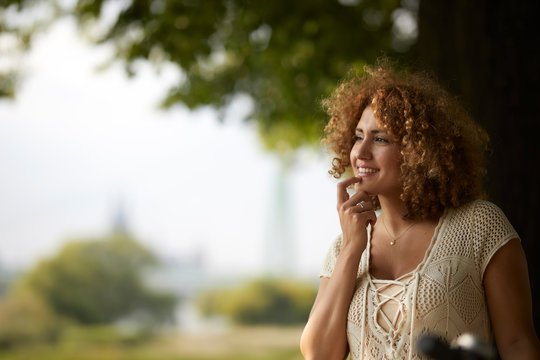 Portrait of smiling woman outdoors