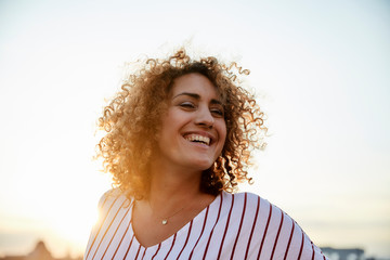 Portrait of smiling woman in the evening light