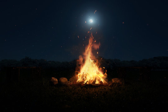 3d rendering of big bonfire with sparks and particles in front of forest and moonlight