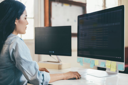 Programmer is coding and programming software. Software developer typing data code, working on project.