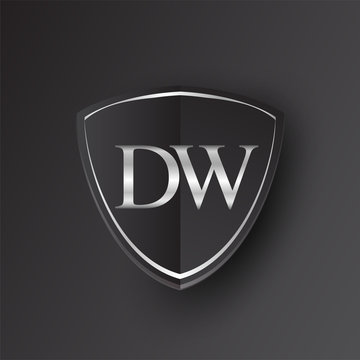Initial logo letter DW with shield Icon silver color isolated on black background, logotype design for company identity.