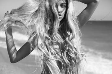 Beautiful blonde woman on the beach