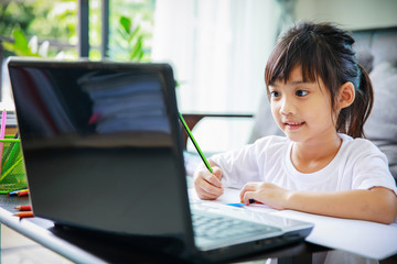girl remote schooling in study at home