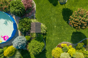 Residential Backyard Garden with Small Swimming Pool Aerial View