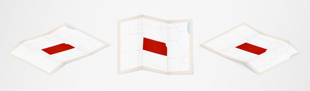 Folded map of Kansas in three different versions.
