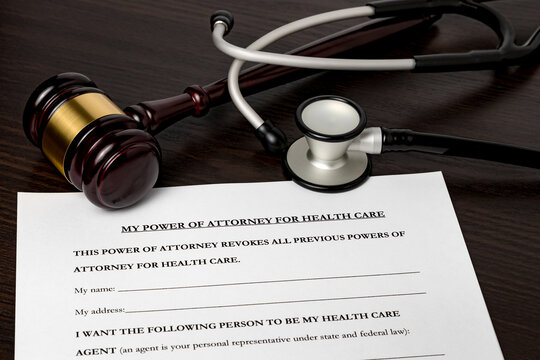 Power of Attorney for health care, HCPA, with gavel and stethoscope. Concept of planning for death, final wishes, terminal illness, and advance directive