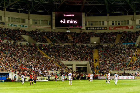 ODESSA, UKRAINE - 2018: Digital ICE A UEFA Champions League billboard is visible in the stadium during a football club game. Electronic information board of football in the stadium during the game