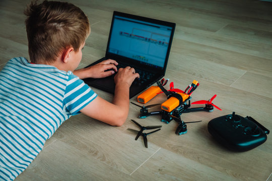 boy programming drone, STEM education. Learning modern technology