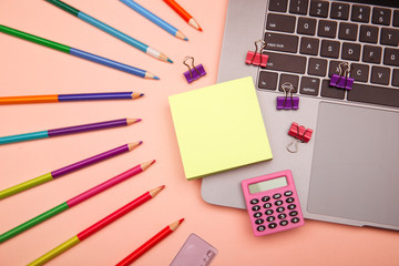 Back to school concept - school office supplies on pink background.