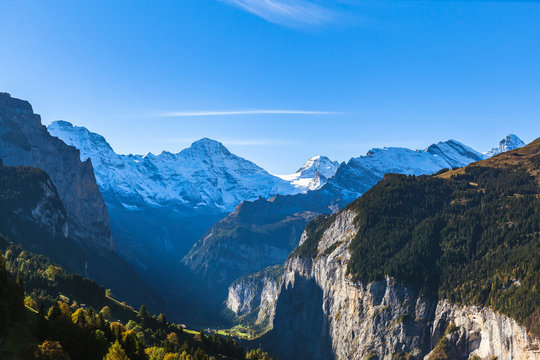 Stunning panorama view of Breithorn and Swiss Alps on Bernese Oberland and the Lauterbrunnen valley on sunny summer day from Wengen, Canton of Bern, Switzerland.