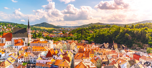 Panoramic view of Cesky Krumlov with St Vitus church in the middle of historical city centre. Cesky Krumlov, Southern Bohemia, Czech Republic