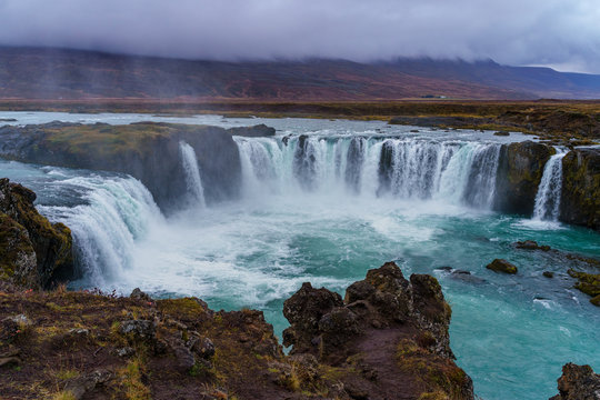 Goðafoss Waterfall on a gloomy and misty autumn afternoon
