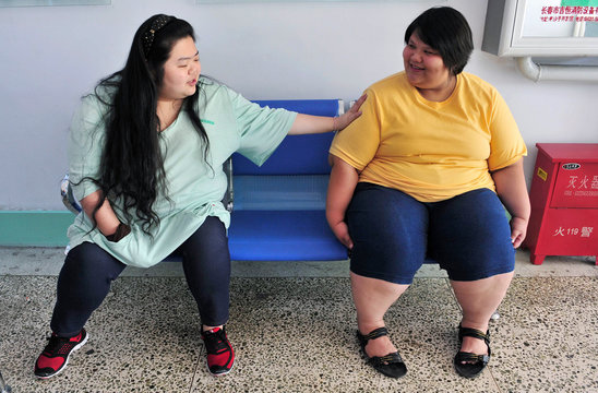 Patients chat with each other at a weight loss centre in Changchun