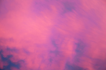 Blurred pink clouds in the sky, abstract background