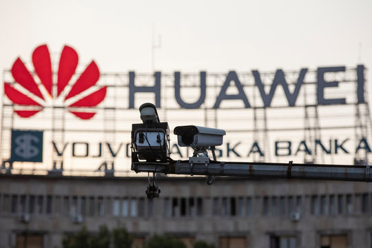 A surveillance camera is seen in front of a Huawei logo in Belgrade