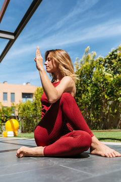 Beautiful young woman doing yoga postures