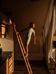 Boy climbing staring of bunk bed in room