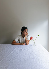 Moody portrait of girl and flowers