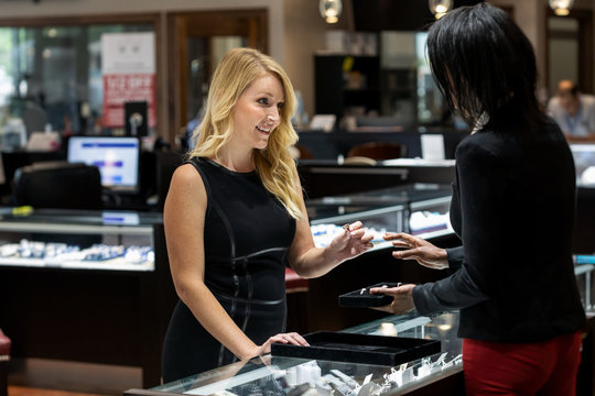 Jewelry: Woman Ring Shopping In Upscale Store