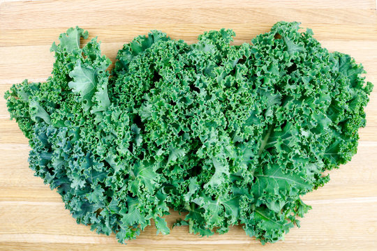 Fresh and Organic Kale Set on A Wooden Cutting Board