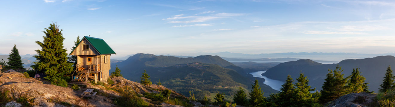 View of Tin Hat Cabin on top of a mountain during a sunny summer evening. Located near Powell River, Sunshine Coast, British Columbia, Canada.