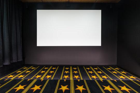 Home cinema with blank movie screen