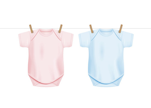Newborn baby onesie shirts hanging on drying rope with wooden clothes pegs