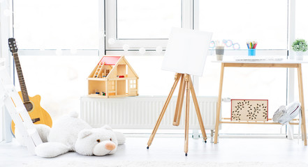 Beautiful interior of cozy children's room with toys