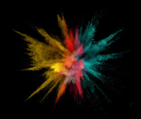 Fototapete - Colorful powder explosion isolated on black background