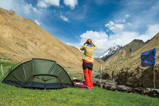 Traveller on the trekking on Markha valley trek route in Ladakh, Karakorum panorama. This region is a purpose of motorcycle expeditions organised by Indians