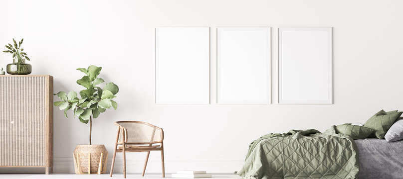 Fresh , comfortable bedroom with three vertical frames in bright design, poster mock up on white wall background