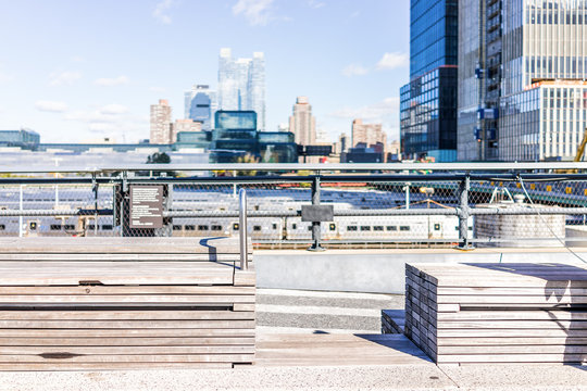 Highline, high line, urban wooden minimalistic minimal benches in New York City NYC with nobody in Chelsea West Side by Hudson Yards