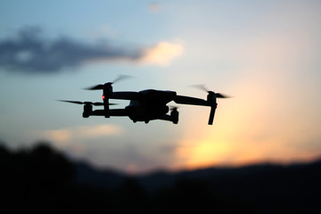 Close up picture of drone in the sky at sunset