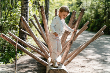 Cute girl standing on wood in forest