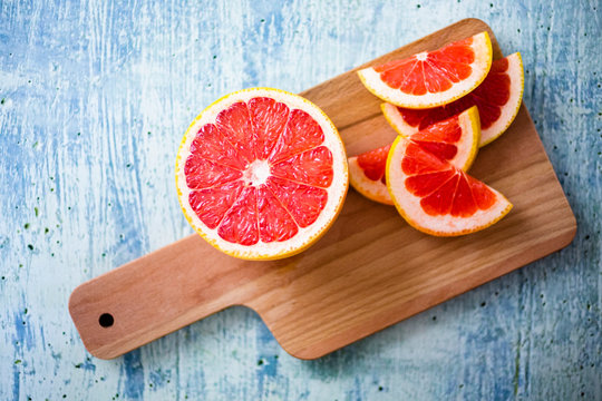 Fresh grapefruit on chopping board
