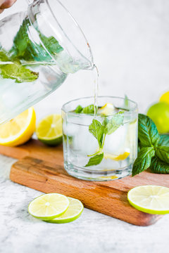 Detox water with lemon, lime and mint and ice cubes